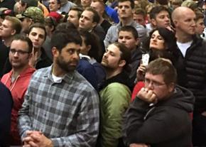 Trump supporters wait for their candidate to speak at a Michigan rally