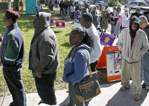 Voters in North Carolina wait in line for hours to cast their ballots