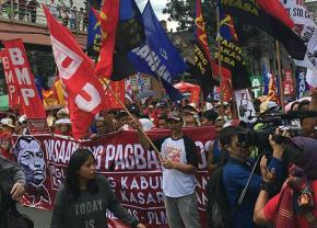 Workers in the streets of Manila to protest the hero's burial of ex-dictator Ferdinand Marcos