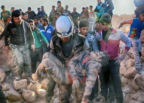 Residents of Aleppo pull victims from the rubble after another regime bombing