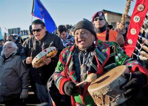 Water protectors celebrate after hearing the U.S. Army Corps of Engineers' decision
