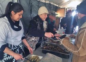 Volunteer chefs serve water protectors in the Oceti Sakowin camp at Standing Rock