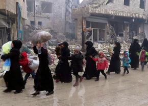 Residents of Eastern Aleppo flee during the final assault by the Assad regime