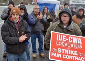 Striking workers at Momentive Performance Materials rally on the picket line