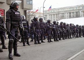 A phalanx of police officers prepares to face down protesters during Trump's inauguration