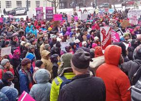 Supporters of Planned Parenthood rally at City Hall in Portland, Maine