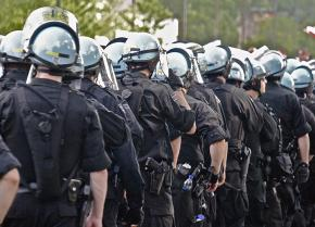 A column of riot police prepares to confront protesters in Chicago