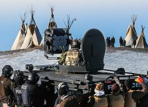 A militarized police unit prepares to arrest dozens of water protectors at Standing Rock, North Dakota