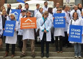 Climate scientists stand up outside the American Geophysical Union meeting in San Francisco