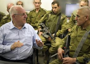Israeli President Reuven Rivlin (left) talks with a group of military commanders near the Gaza border