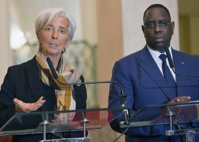Christine Lagarde of the International Monetary Fund (left) speaks alongside Senegalese President Macky Sall