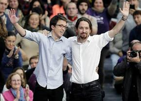 Podemos leaders Íñigo Errejón (left) and Pablo Iglesias greet supporters at the party conference in Vistalegre