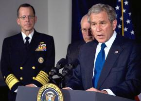 George W. Bush speaks at the Pentagon flanked by Dick Cheney and Joint Chiefs of Staff Chair Mike Mullen (left)