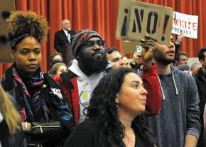 Students at Middlebury College stand up against racism during a lecture by Charles Murray