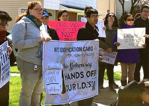 Activists protest an anti-immigrant lawsuit outside the home of New York State Assembly member Nicole Malliotakis
