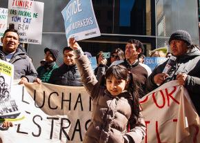 Workers and family members rally at the Tom Cat Bakery in New York City