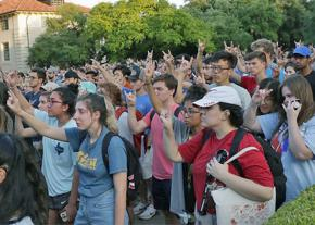 Thousands attend a vigil for slain student Harrison Brown at UT Austin