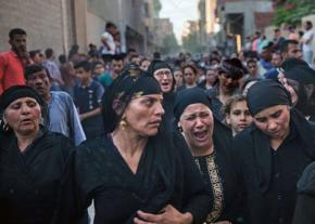 Family and friends mourn the victims of a deadly attack on Coptic Christians in Egypt