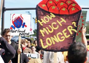 Supporters of the farmworkers' campaign march outside a Wendy's shareholders meeting