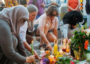 Community members mourn the victims of an Islamophobic attack in Portland