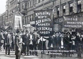 A socialist contingent in Petrograd with banners calling for peace, land and soviet power