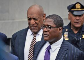 Bill Cosby (left) enters the courthouse