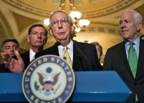 Senate Majority Leader Mitch McConnell speaks with reporters