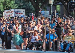 Protesters rally outside the Capitol building in Austin, Texas, to demand universal health care
