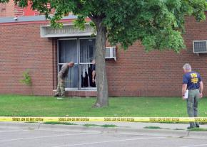 Damage from a bomb thrown in the window of the Bloomington mosque