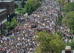Thousands flood the streets of Boston to protest the Nazis
