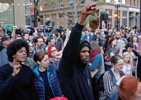 Standing in solidarity with Charlottesville at a vigil in Oakland, California