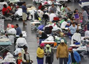 Victims of Hurricane Harvey seek shelter in a Houston convention center