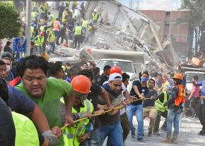 Volunteers help clear the rubble after the Mexico City earthquake