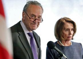 Democratic congressional leaders Chuck Schumer (left) and Nancy Pelosi speak to reporters