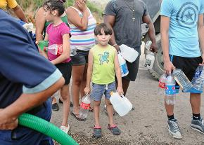Families line up for water in Puerto Rico