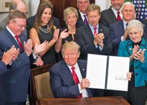 Donald Trump signs an executive order on health care