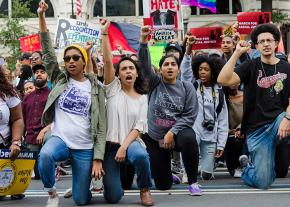 Protesters take a knee at the March for Racial Justice in Washington, D.C.