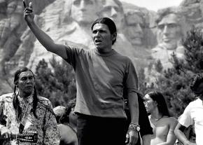 Dennis Banks leads a protest in front of Mount Rushmore