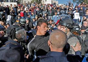 Israeli soldiers arrest Palestinian protesters during mass demonstrations in Jerusalem