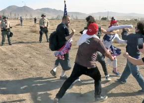 Alt-right thugs attack ant-racists protesting Trump's border wall as the police look on