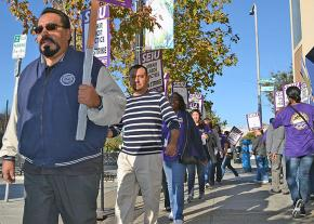 City workers walk the picket line in Oakland, California