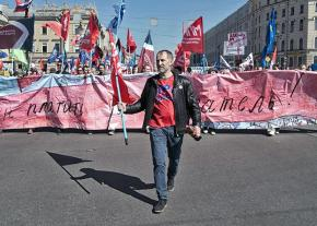 Russian labor activist Alexei Etmanov leads a demonstration of autoworkers through St. Petersburg