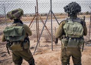IDF soldiers patrol the borders of Gaza near the Kerem Shalom crossing