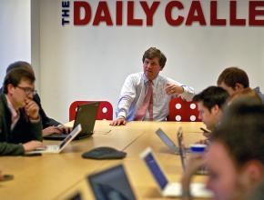 Fox News pundit Tucker Carlson leads an editorial meeting of the Daily Caller