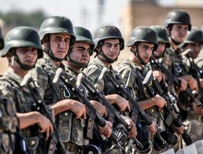 Turkish soldiers prepare for invasion at the border with Syria