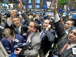 Wall Street traders jostle on the floor of the New York Stock Exchange