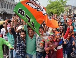 Supporters of the right-wing Bharatiya Janata Party celebrate an election win