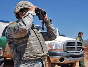 A California National Guard soldier (left) accompanies federal agents patrolling the U.S.-Mexico border