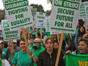 Striking workers at the University of California take to the streets of downtown Berkeley