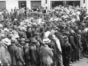 African American stockyard workers line up for emergency wages during the Chicago Race Riot of 1919
